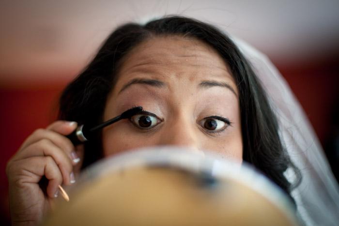 bride looking into mirror mascara