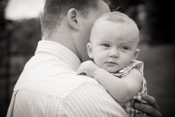 black and white baby over dad's shoulder