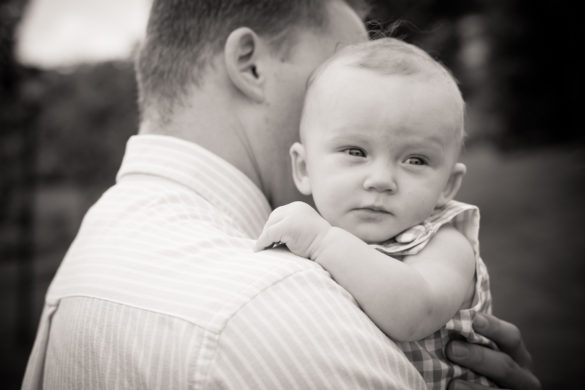 dad holding baby