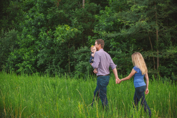 grassy field family photo candid