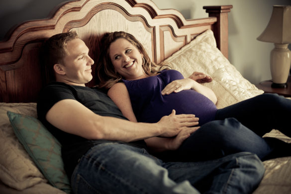 maternity session bedroom couple laughing