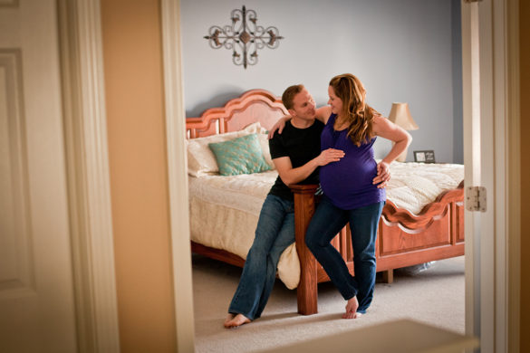 maternity session bedroom couple