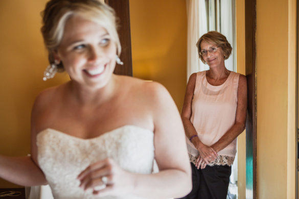 mom watching bride prepare