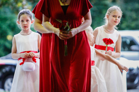 flower girls peak into church