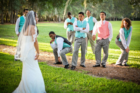 groomsmen funny poses making bride laugh