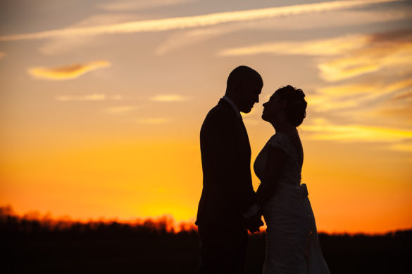 sunset silhouette bride and groom