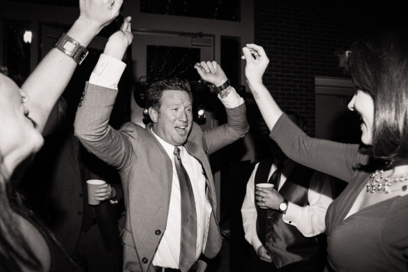 wedding guests hands in the air reception