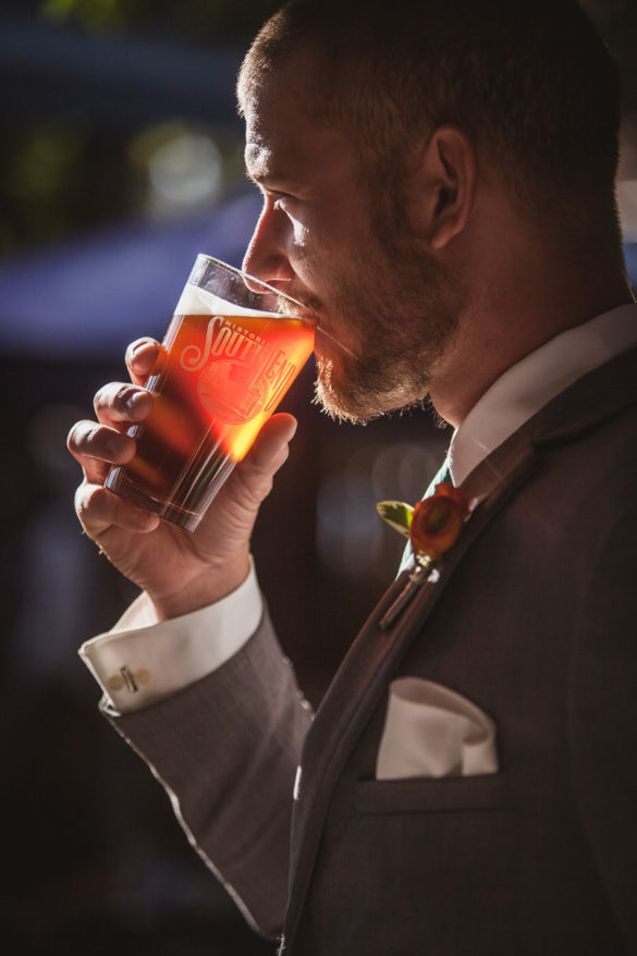 groomsman drinking craft beer