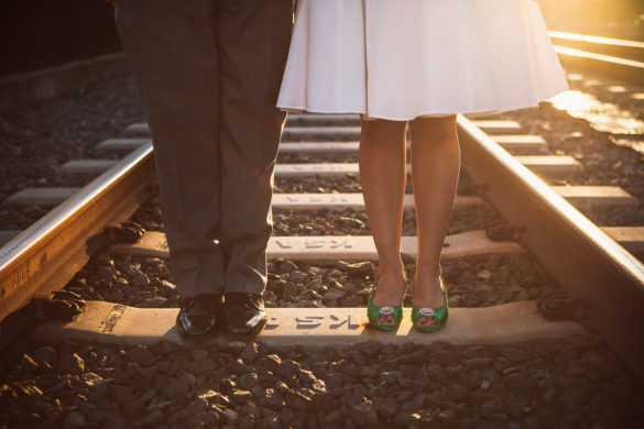 bride and groom shoes train tracks