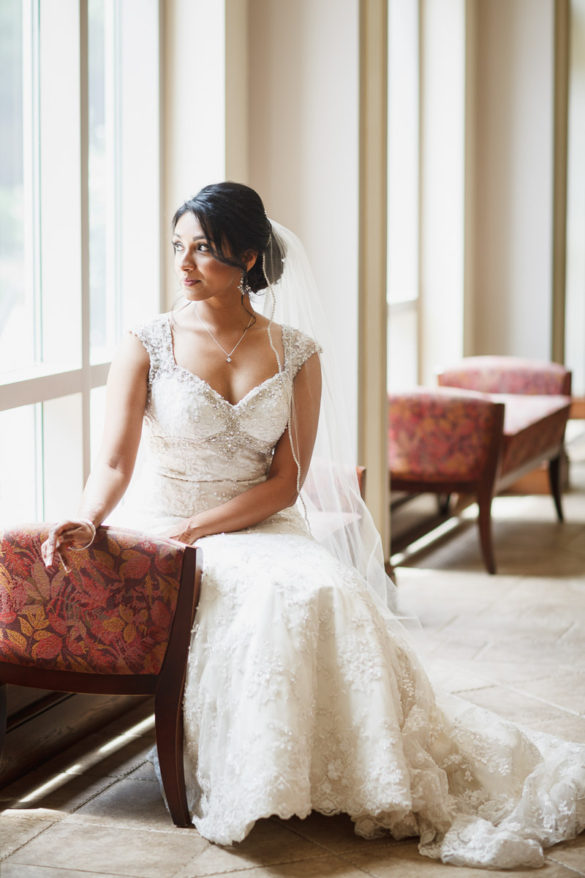 bride sitting by window saint patrick cathedral charlotte