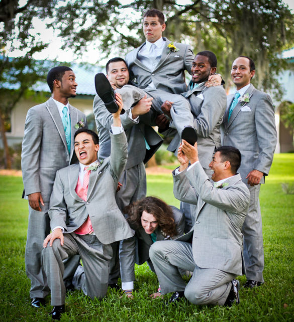 groomsmen lifting groom funny poses