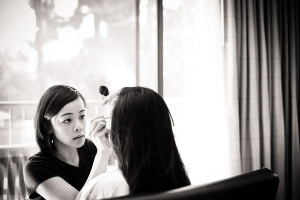 makeup artist with bride