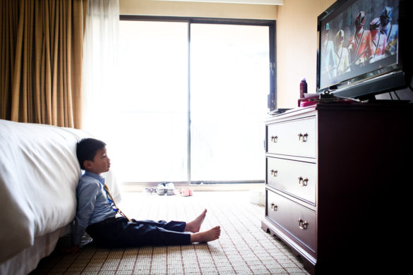 boy watching cartoons on wedding day