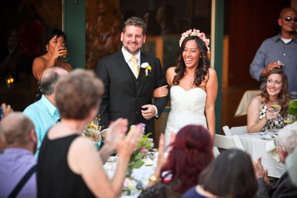 bride and groom smiling grand entrance
