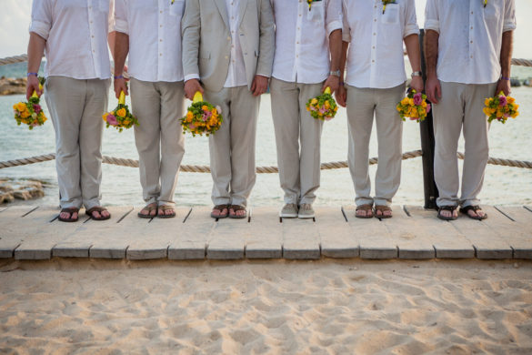 groomsmen with wedding bouquets