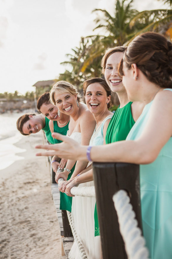 bridesmaids laughing beach