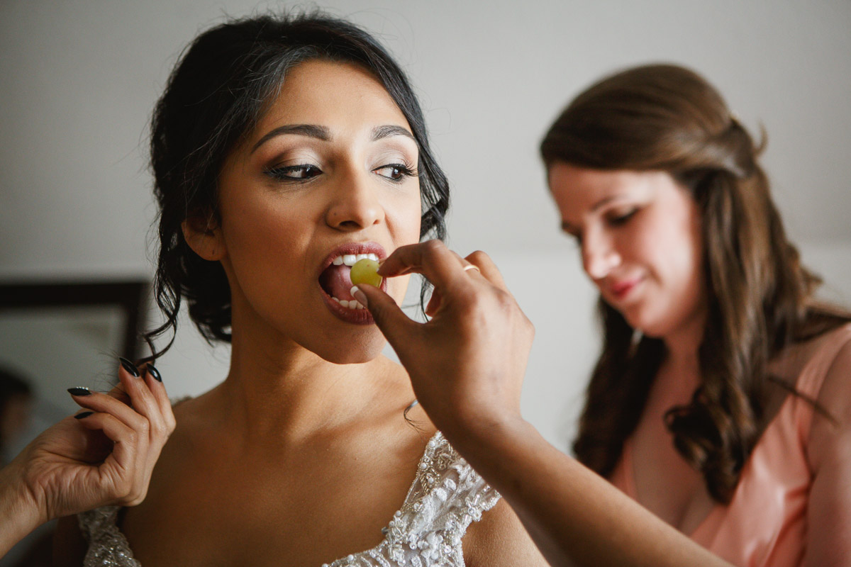 bride eating grapes