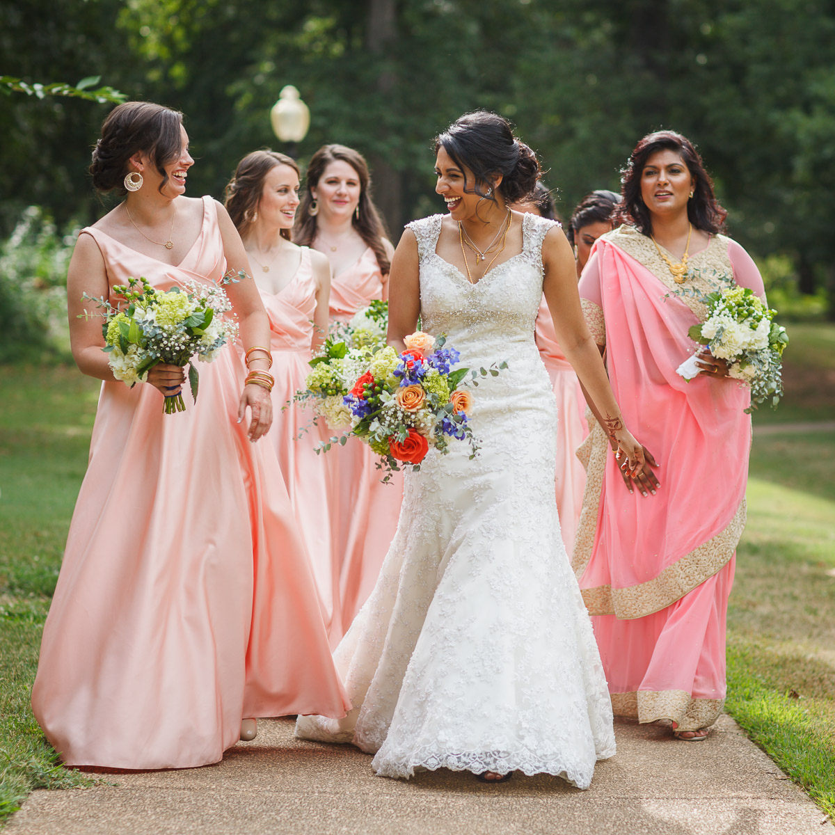 candid bridal party walking